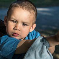 When a baby boy should start talking?