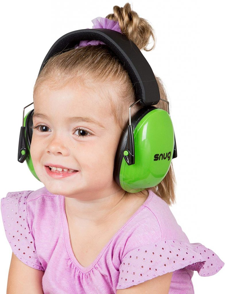 A kid wearing snug earmuffs. Looks comfy and cute?