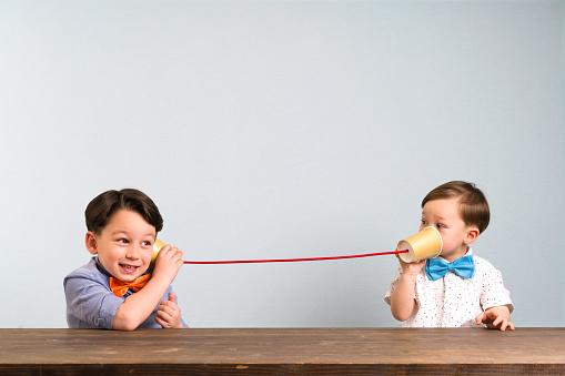 Children playing a game that enhances speech